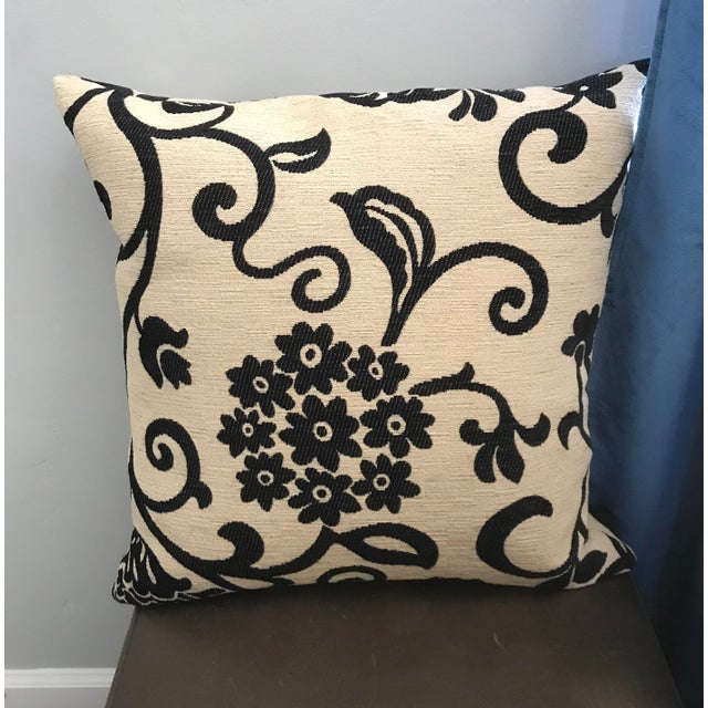 Beautiful and classic! Cream base with black floral design Woven fabric Down insert Hidden zipper closure