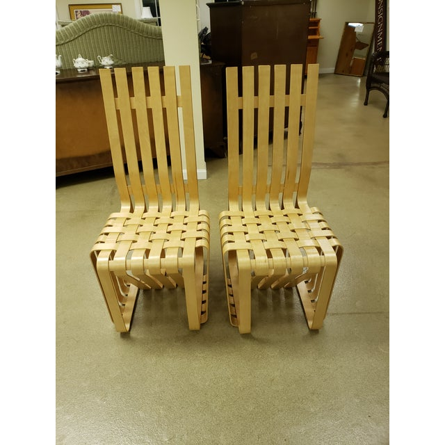 Beautiful white maple collector chairs. Great condition. Very unique signed by the designer Frank Gehry on the bottom....