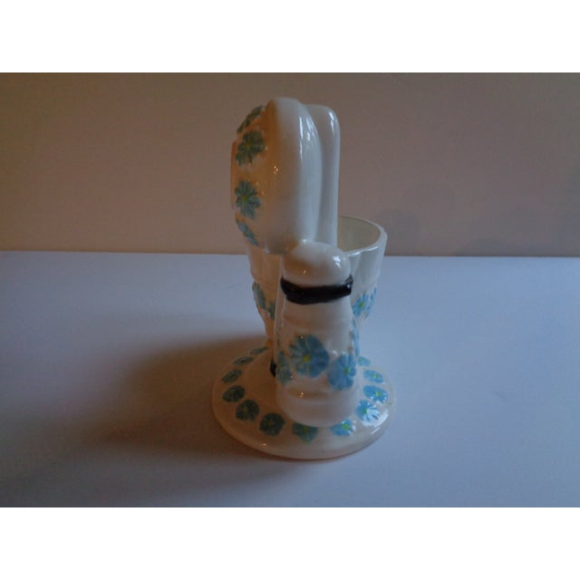 Kitschy mid-century pencil cup. Blue and white ceramic. Made in Japan. In shape of old-fashioned telephone. In very good...