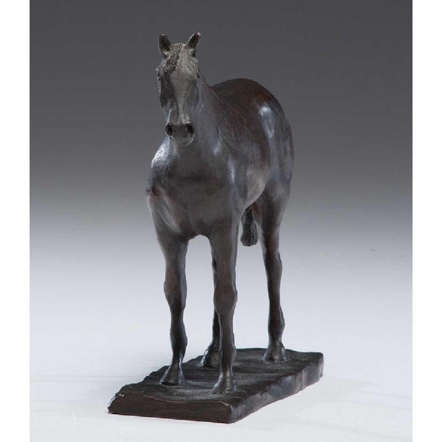 A ronze Horse by Tom Hewlet signed and dated 1973 Tom Hewlet 1898-1981 British-Ameican sculptor praised for his equestrian...