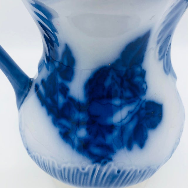 Beautiful Ironstone Staffordshire Flow Blue Pitcher. This medium size beauty is stamped on the bottom and in wonderful...