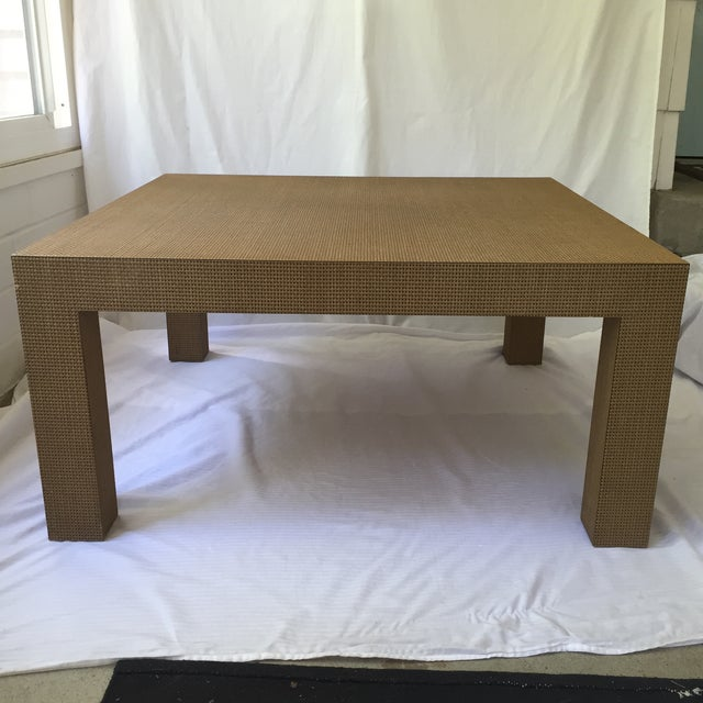 Absolutely stunning Parsons style coffee table with a woven laminate surface sealed with lacquer to prevent wear to the...
