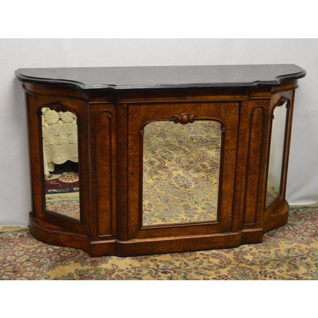 The marble top and some carved trims are not original. The marble is removable and in excellent condition. The key doesn't...