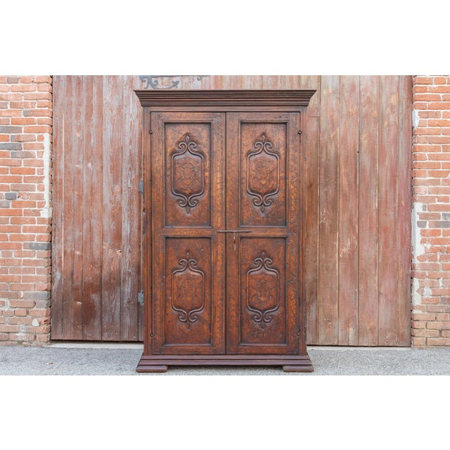 Exquisite floral ivy inlaid marquetry armoire. This antique armoire has traditional Spanish Basque aesthetics. Made of...