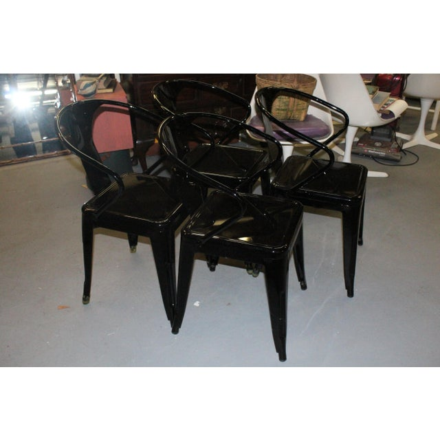 Set of 4 outdoor modern metal chairs painted black. Perfect for a modern home.