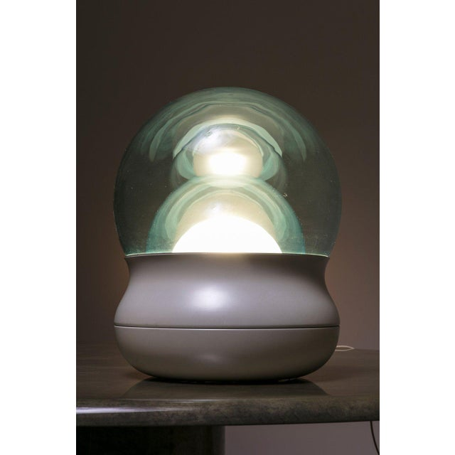 Remarkable table lamp model TL278 manufactured by Stilnovo. Aluminum base hosts three increasing diffusers in opal and...