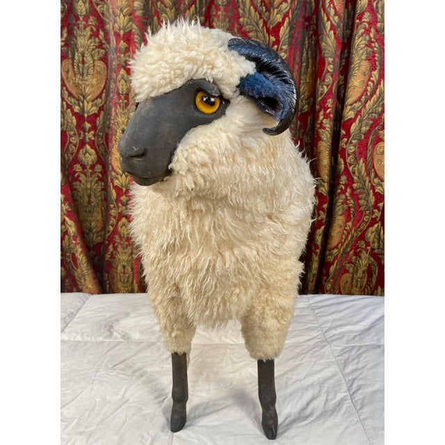 Life size sheep Ottoman made of wood and sheepskin. Whimsical and playful, makes a striking statement in a variety of...