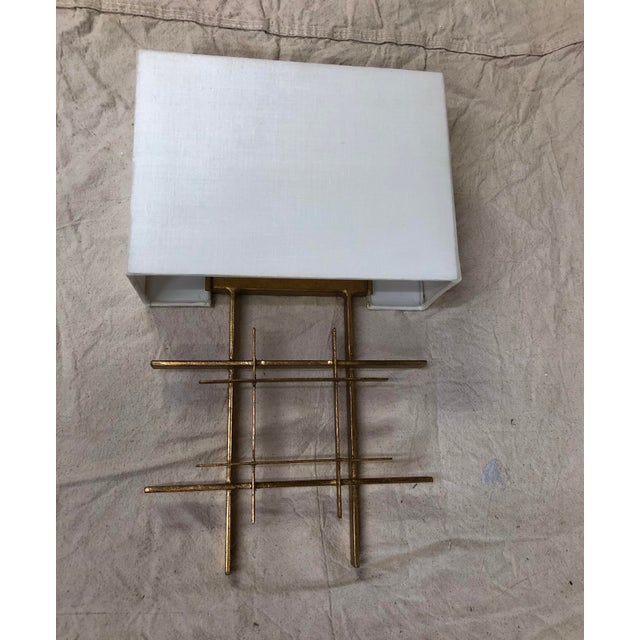Wrought Iron crosshatches with Antique Gold Leaf finish. White linen shade. Showroom sample. light wear. Current stock.
