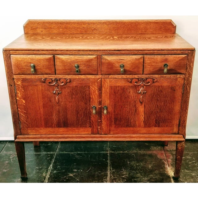 India Street Antiques refinished the exterior of this simplistic and attractive sideboard to expose the natural beauty of...