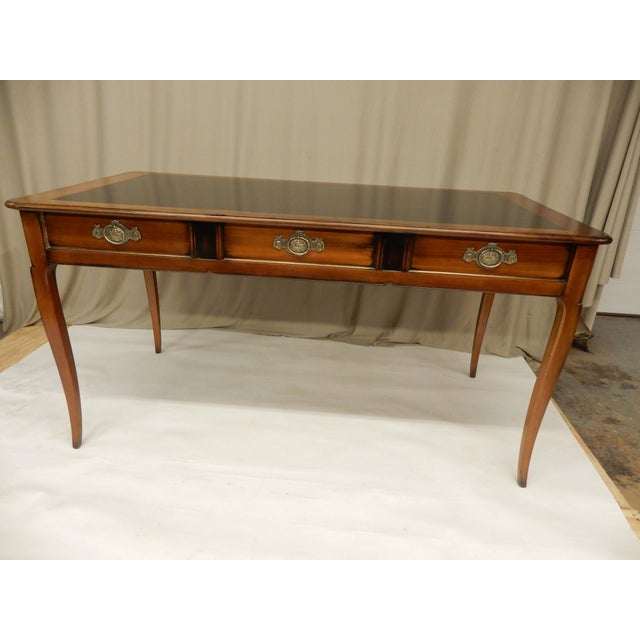 French walnut vintage partners desk. Drawers only open on one side. Brass trim on drawers and has a partial black...