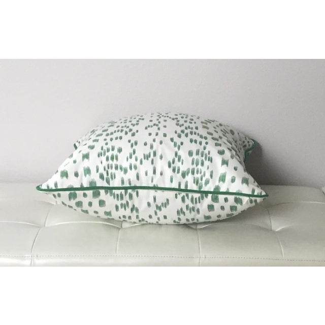 Modern and fresh animal print hand printed on a heavy weight cotton fabric. The colors are shades of greens on an ivory...