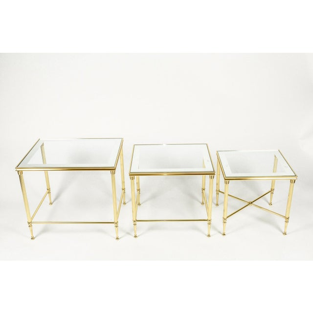"""Set of three midcentury nesting tables with brass frames and glass tops. Large table: 16""""W x 20.5""""L x 18.5""""H; medium..."""