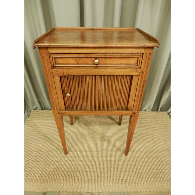 Beautiful pale walnut 19th century side table with slide back front and one draw.