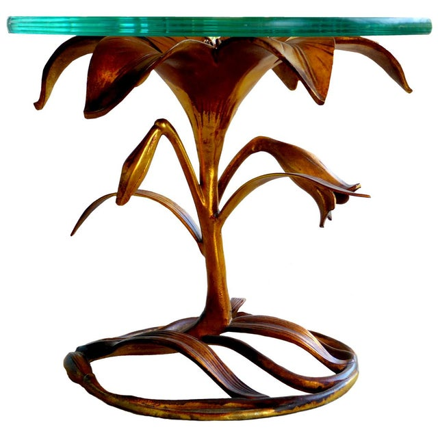 Often attributed to Arthur Court, this Lily occasional table by Drexel is a lovely vision of aluminum dipped in gold....