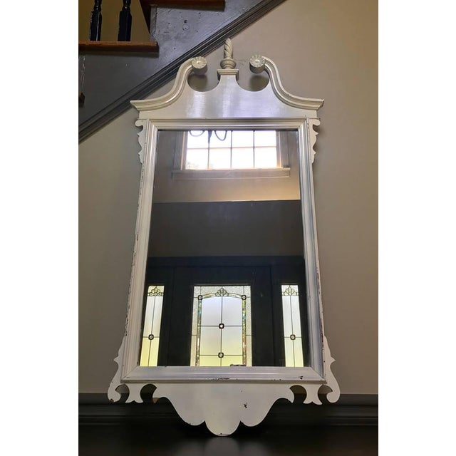 Vintage Neoclassical style mirror in shell white with distressed finish. Good condition; overall slight distressed look,...