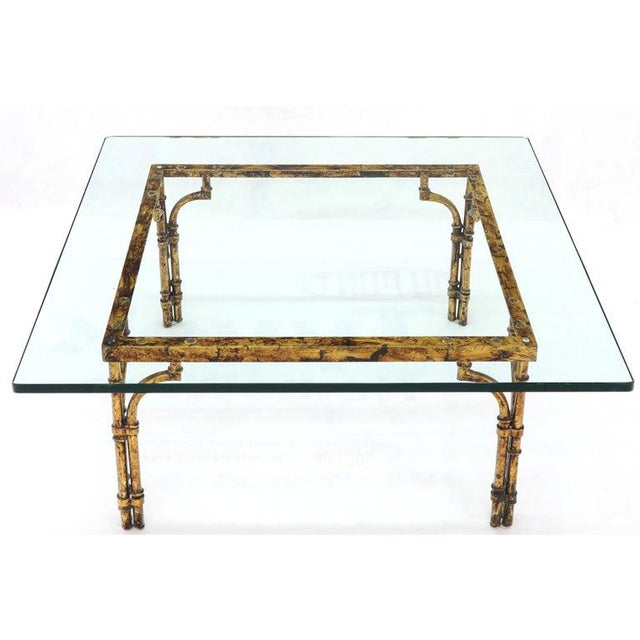 Mid-Century Modern square glass coffee table on faux bamboo gold gilt base