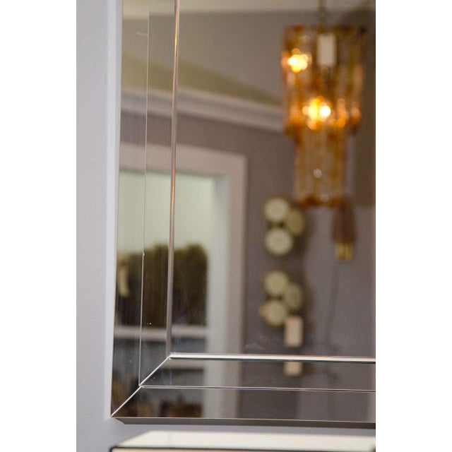 Custom tiered stacked mirror.