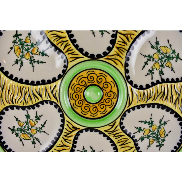 A Faïence oyster plate from the Quimper region of France, circa 1940s. Produced by Paul Fouillen, a potter who left the...