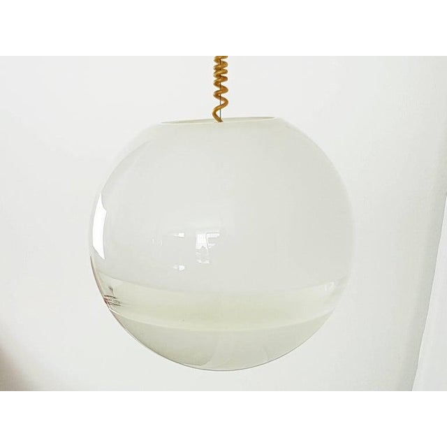 This is a beautiful 1960s Mid Century Modern Italian Murano glass pendant light, designed by Roberto Pamio for Leucos. The...