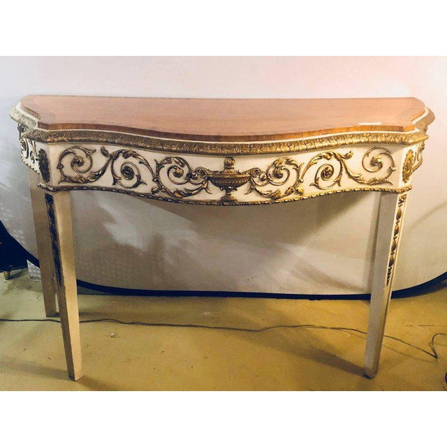 A painted console or demilune table fine wood top Louis XV style by Maison Jansen. Parcel-gilt and paint decorated with a...