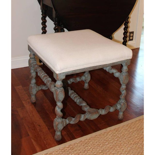 An 18th century large, Swedish Baroque period painted stool with turned legs, newly upholstered in C & C Milano fine...