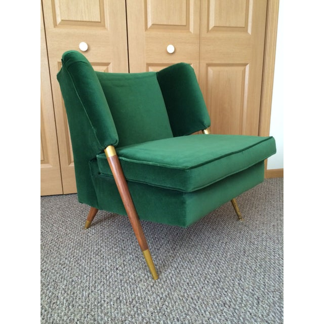 We are Green with Envy! This stunning Mid-Century chair will make a beautiful addition to your home. It's sleek design and...