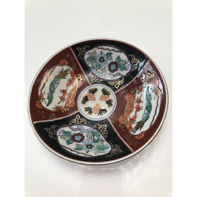 Hand painted catch-all/trinket dish made expressly for the Ritz Carlton. Rich Imari red and black with celadon green birds...