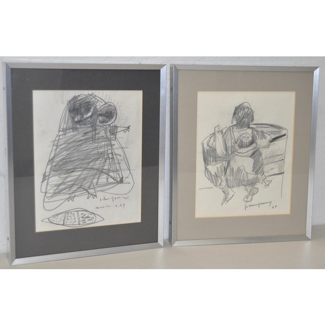 Pair of graphite drawings by noted Hawaiian artist John Young (1909-1997). These original drawings were done in Mexico in...