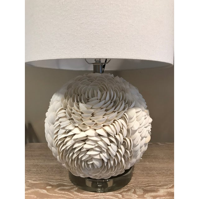 """White natural seashell table lamp with acrylic base and white linen round shade. Dimensions: 21"""" Overall lamp height 14""""..."""