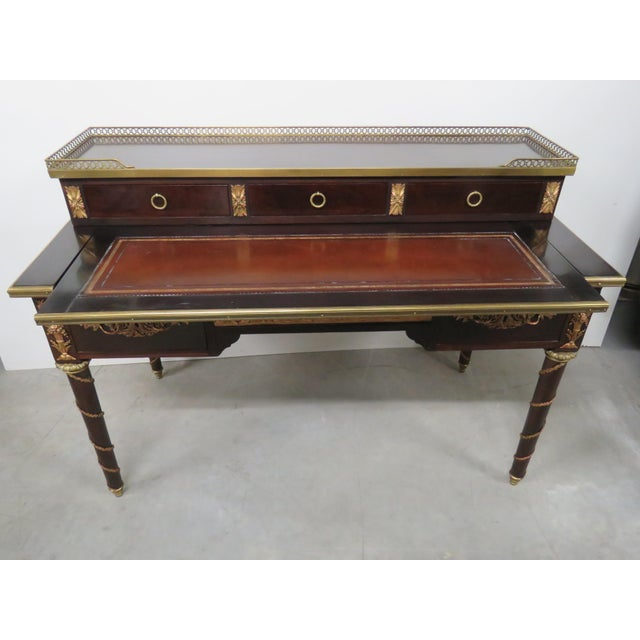 """French Empire style desk with five drawers, brass gallery and decor. Measures: 28"""" D with desk open."""