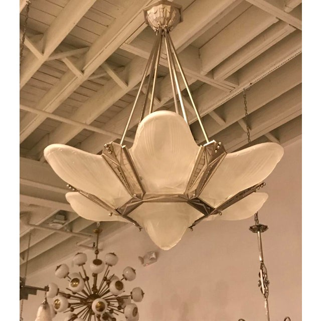 Gorgeous French Art Deco chandelier signed by Des Hanots. With six outer clear frosted glass panels and beautiful center...