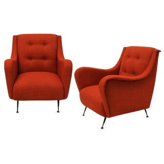 A Pair of Mid Century Armchairs in Burnt Orange