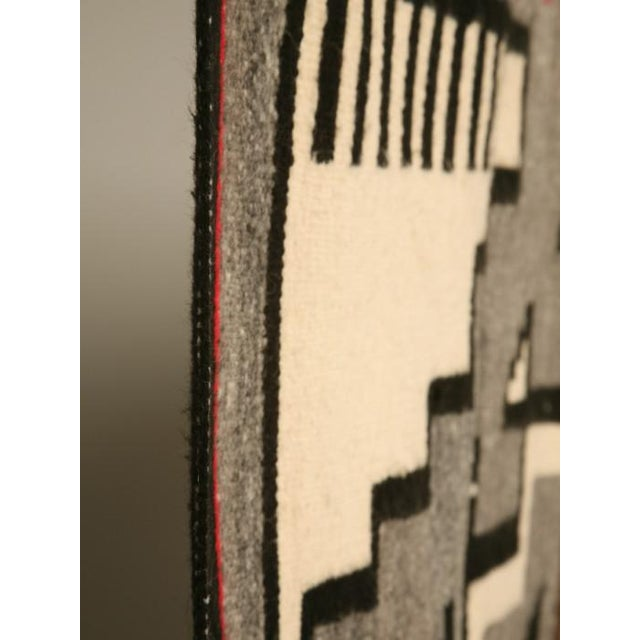 Dynamite hand woven American Navajo Indian rug with a great geometric Southwest design. The warm colors are very inviting,...