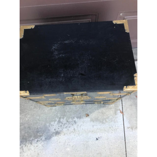 Antique Black lacquer Chinese Cabinet with Brass accents . This side dresser is a great piece. 23 high 21 wide x 14 deep....