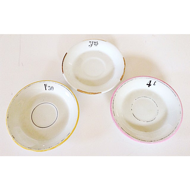 Collection of 3 bistro plates used in France with the price of the item ordered and color coded to make the tally of your...