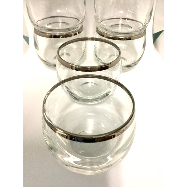 Gorgeous never used set of 6 Dorothy Thorpe silver rimmed glasses. Small but packs a punch of style and glamour. Nice and...