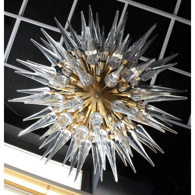 Exceptional huge Murano glass, metal and brass chandelier, circa 1980s. The chandelier has a very impressing size and is...
