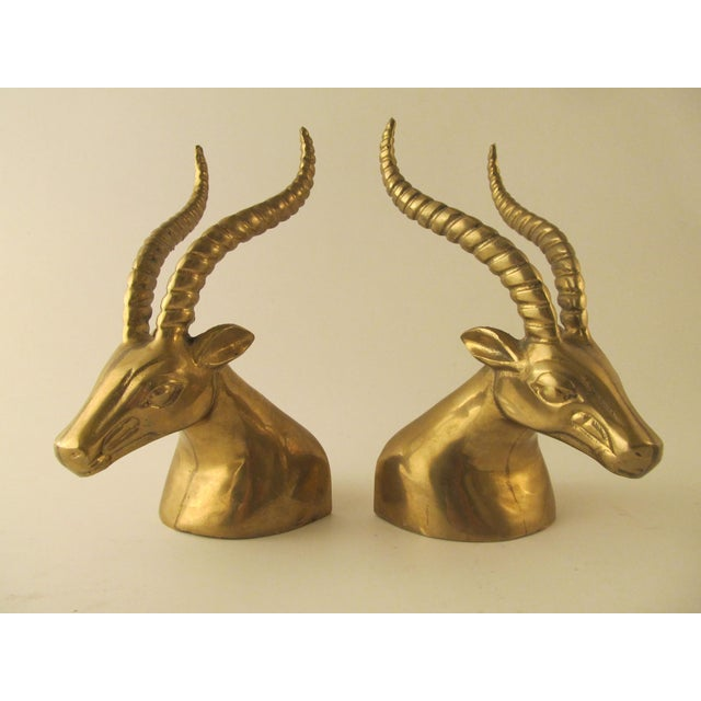 Utterly fierce set of vintage gazelle or ibex head bookends. Incredible quality and design with rich, warm patina. Use...