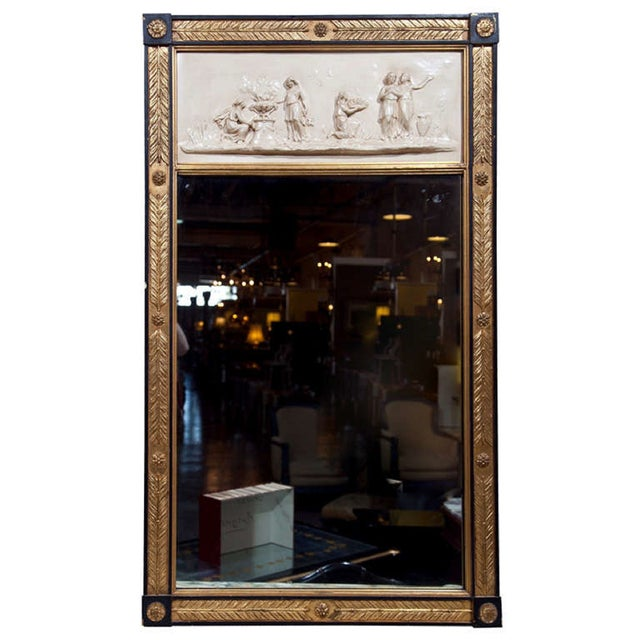 French Trumeau mirror, 20th-century. The cream painted with figural-decorated panel over a rectangular glass, surmounted...