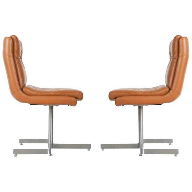Pair of Leather and Steel Lounge Chairs by Raphael, France, Circa 1970 For Sale