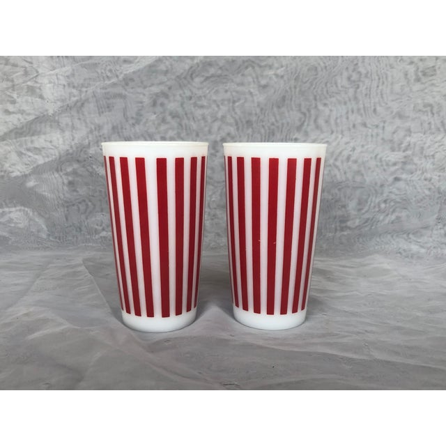 Use these vintage Hazel Atlas red stripe glasses for special cocktails or soft drinks. The classic circa 1940s white milk...