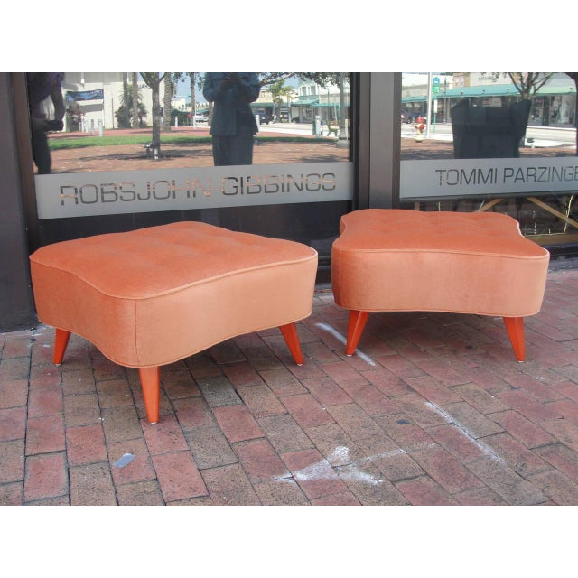 Oversized and heavy in quality, these 1940's ottomans have been carefully restored in lush orange velvet and matching...