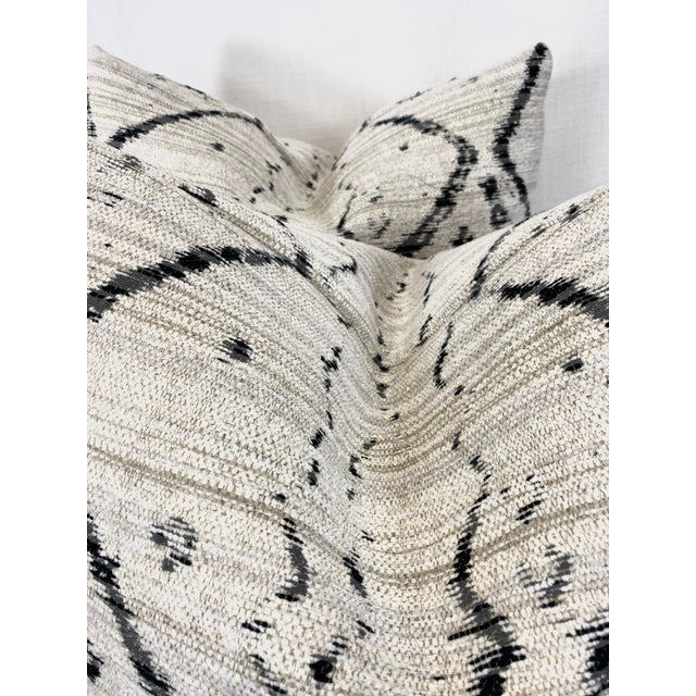 """Custom pair of 22"""" pillows covered in Kravet """" Globe Trot"""" in color Nero. These pillows have tapered corners to prevent..."""