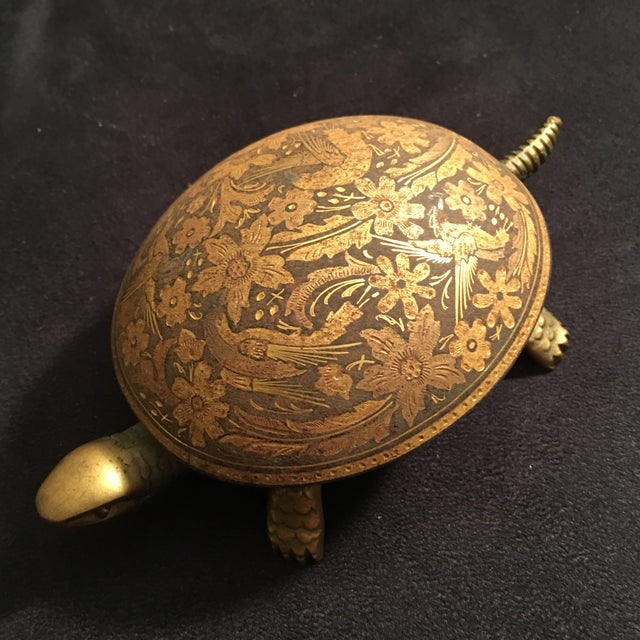 Stunning and unique brass mechanical hand detailed hotel service Bell. Press on the tortoises tail and the bell rings...