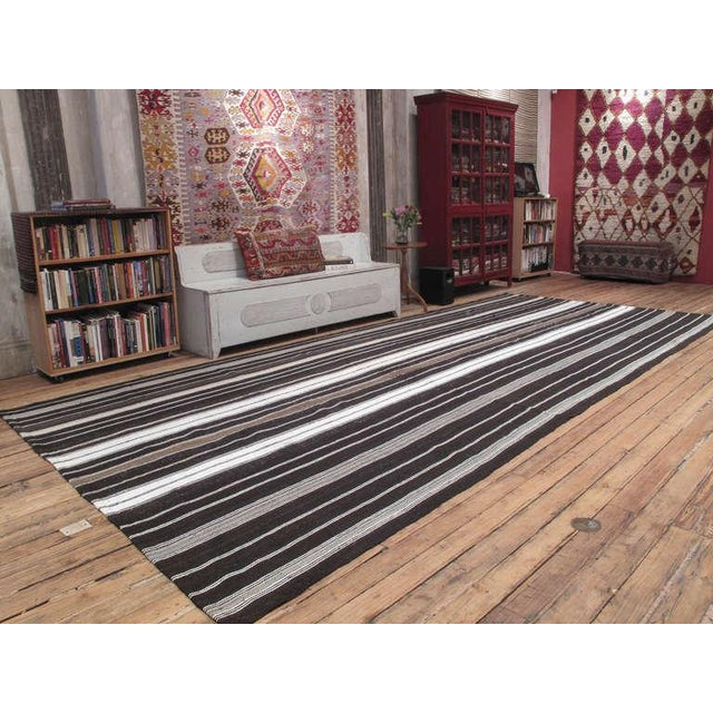 A large tribal floor cover, woven with goat hair in natural tones and white cotton. Very high quality weaving in excellent...
