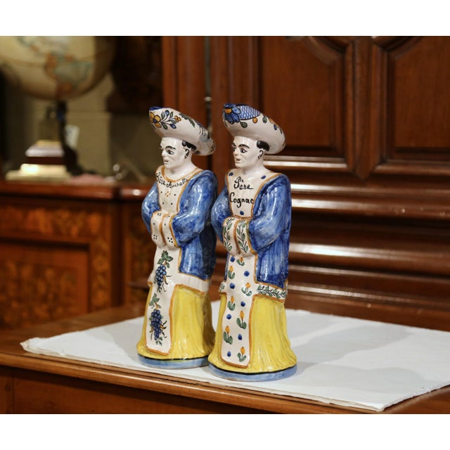 Accessorize your wet bar with this colorful pair of antique ceramic figures. Crafted circa 1860, the priest figurines,...