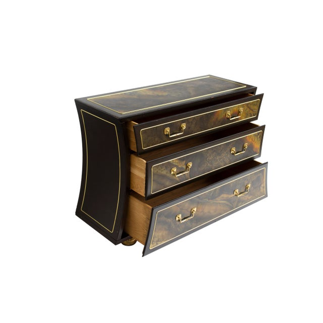 Three drawer chest dresser in acid etched brass designed by Bernhard Rohne for Mastercraft. The sides each have a gentle...