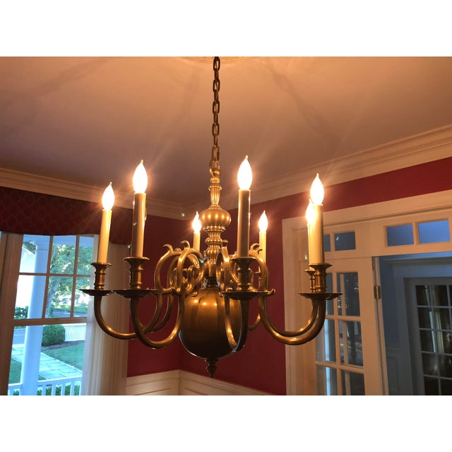 EF Chapman for Visual Comfort 8 Light Brass Chandelier Made of solid brass in an antique finish In perfect condition...