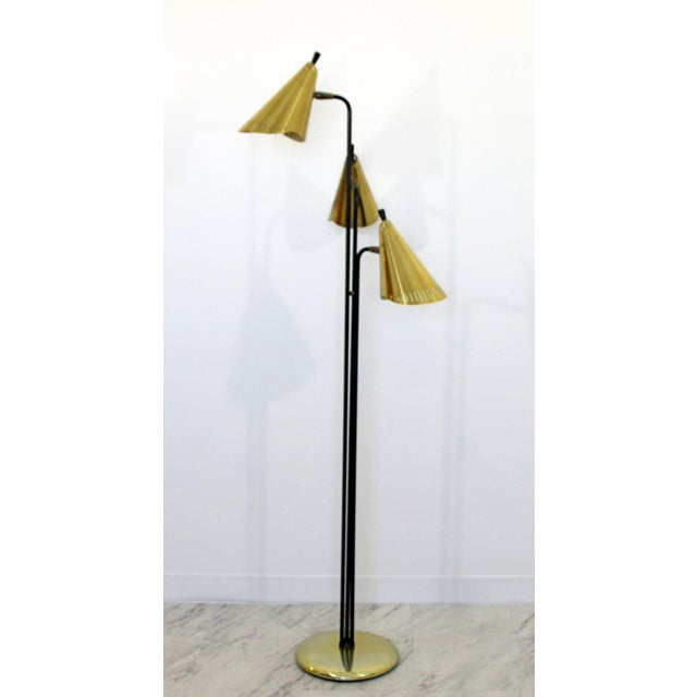 For your consideration is a magnificent floor lamp, with three adjustable brass heads, circa the 1960s. Designed by Gerald...