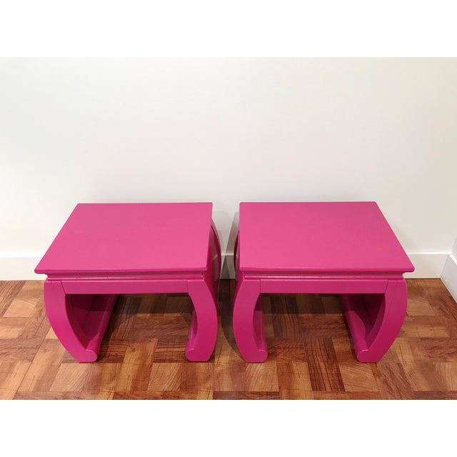 Pop of color tables! Ming style with Chow legs these fuchsia tables can be used as side tables, side by side as a coffee...